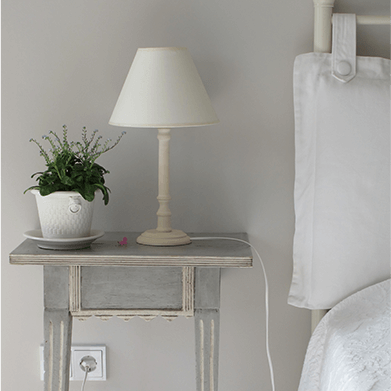 nightstand with light and plant