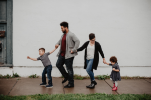 family of four walking down street